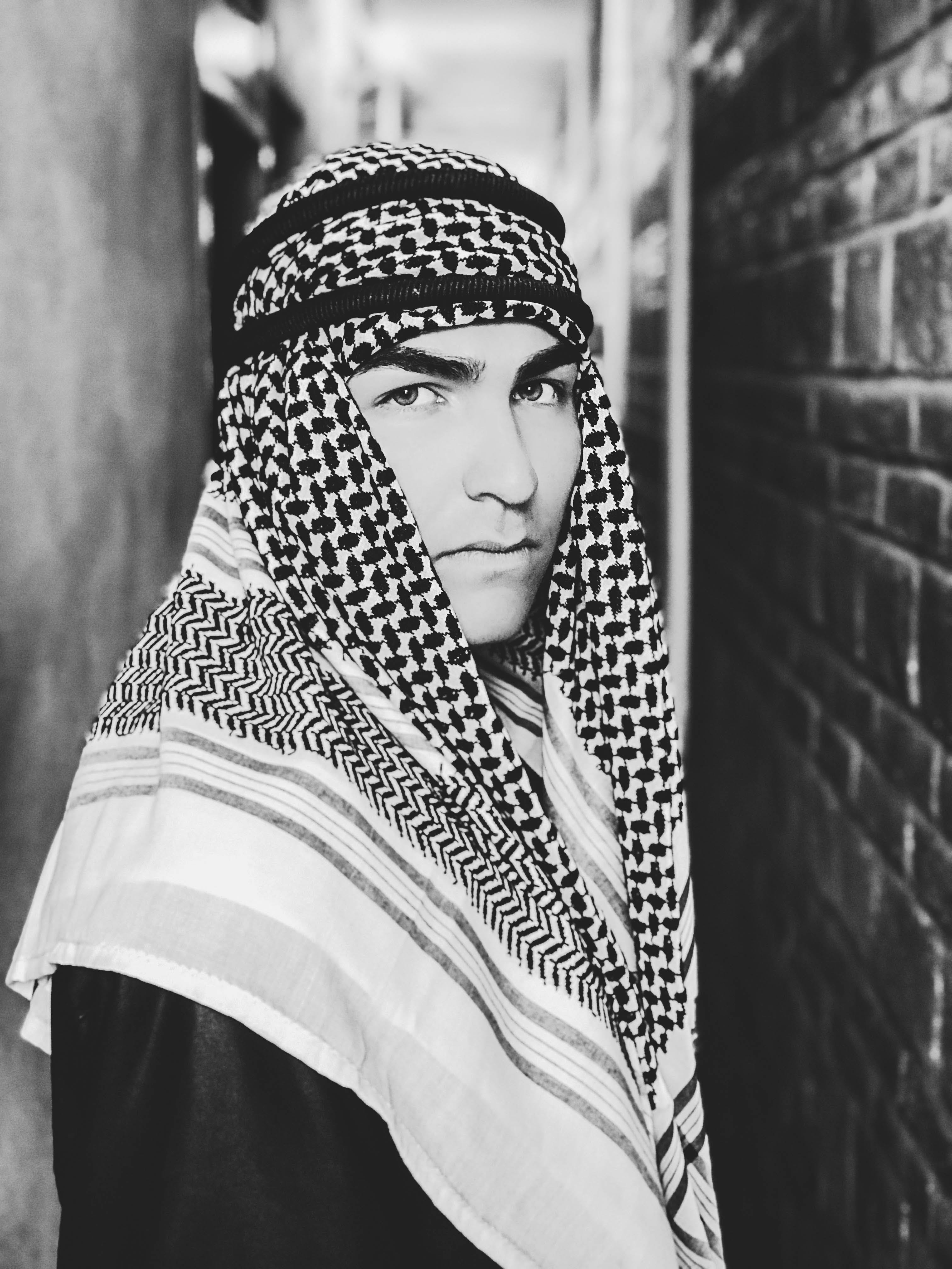 Grayscale Photo of a Man Wearing Keffiyeh