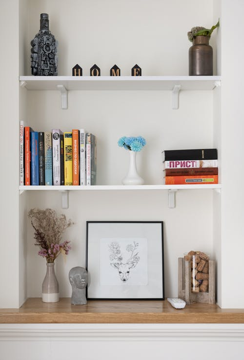 Shelves with decorations in room