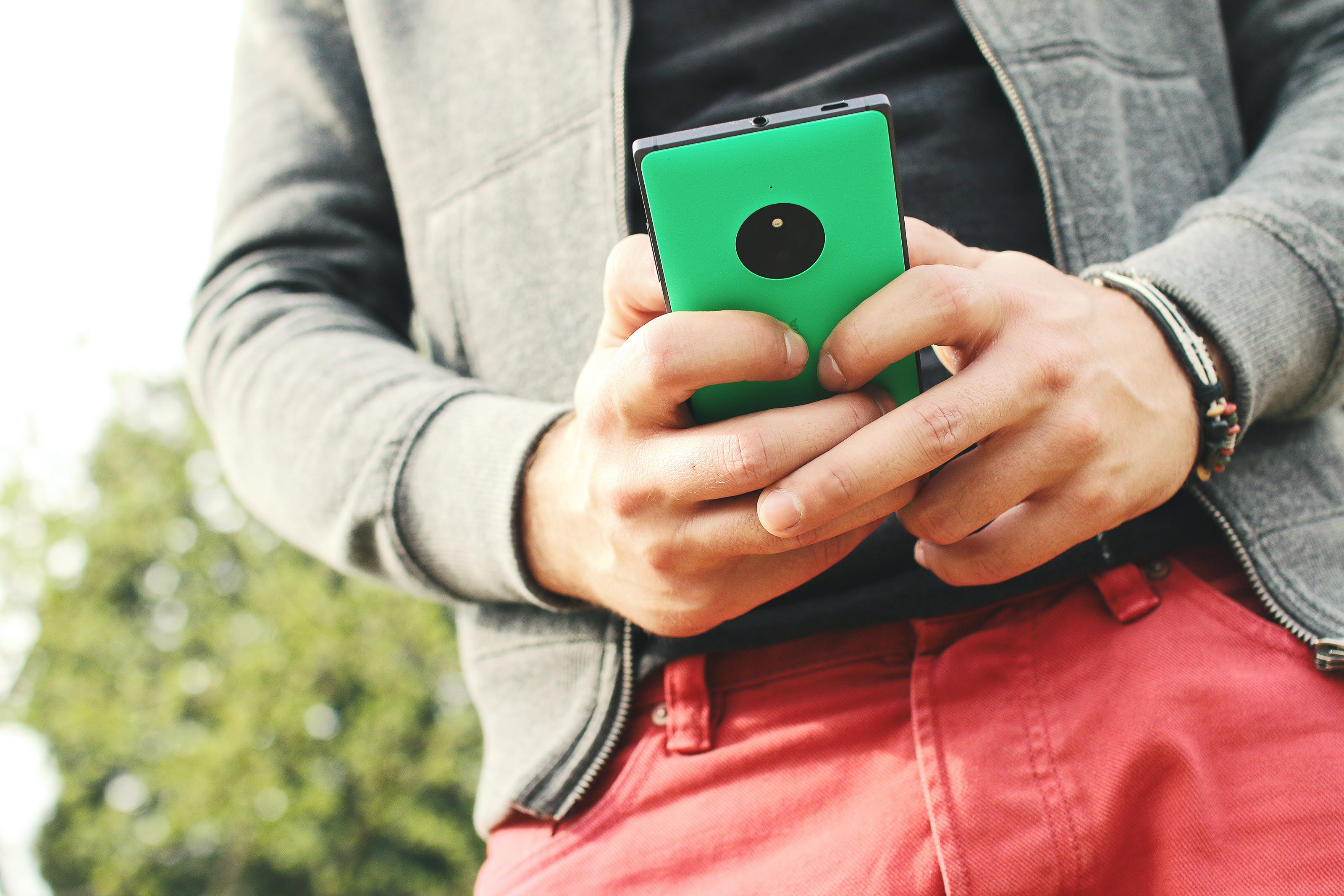 Person Holding Green Smartphone