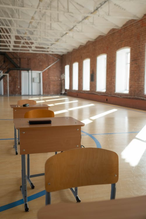 Brown Wooden Desks and Chairs