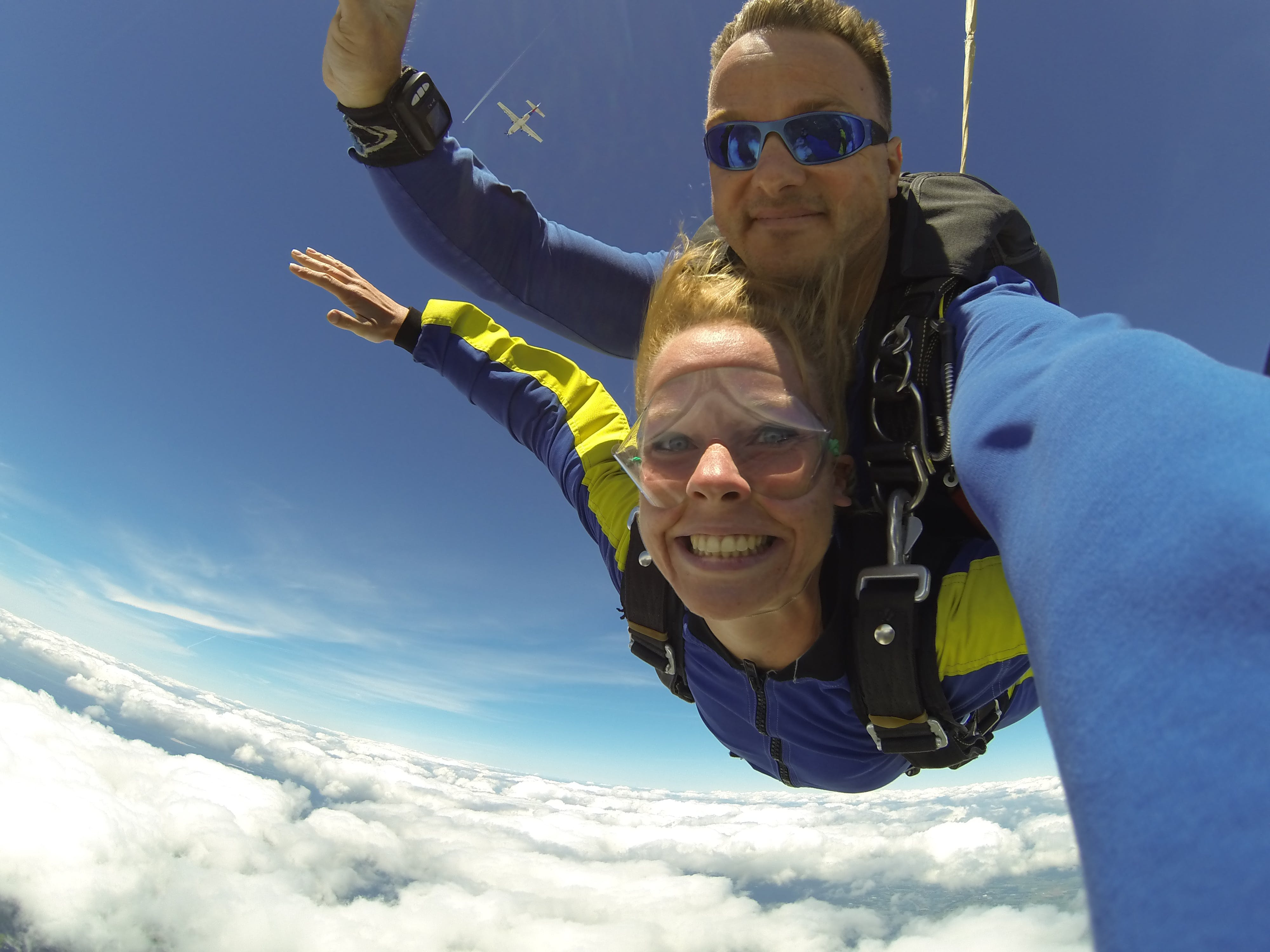 Fisheye Photography of Man and Woman Sky Diving