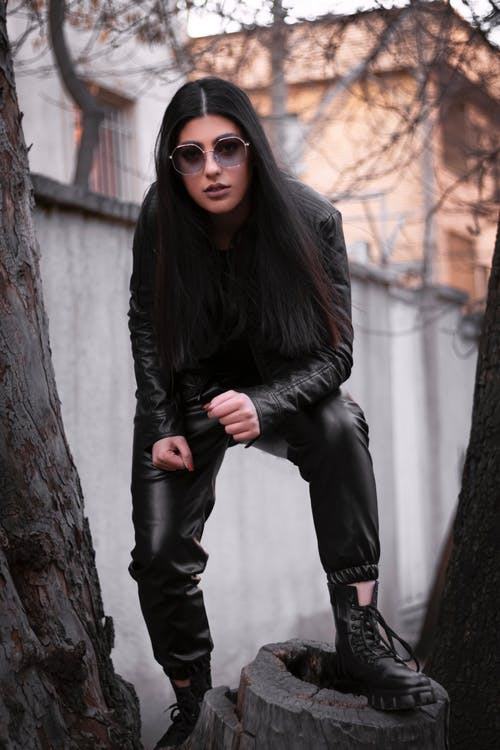 A Woman in Black Leather Clothes