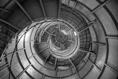Spiral staircase with metal railing inside beacon