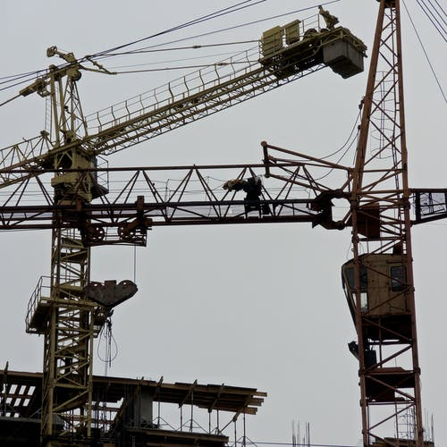 Industrial cranes in construction site