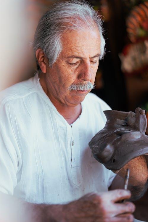 An Elderly Man Working in Pottery