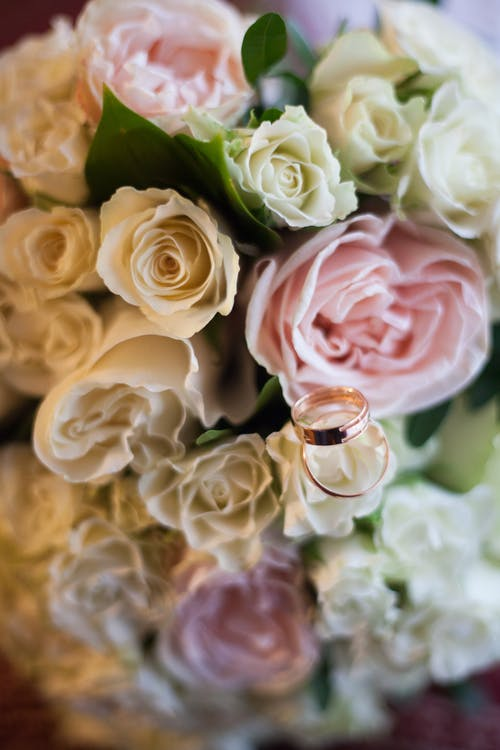 Weddings Rings over a Wedding Bouquet