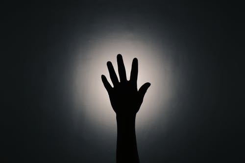 Hand shadow of unrecognizable person