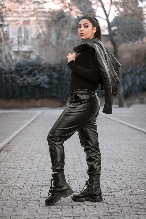 An Attractive Woman in Black Outfit Posing