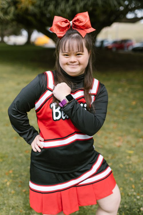 A Woman in Cheerleader Outfit Showing Her Watch