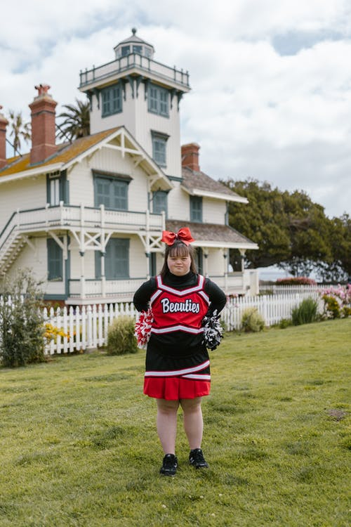 A Woman in Cheerleader Outfit Standing Outside