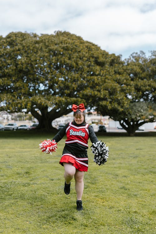 A Woman in Cheerleader Outfit Dancing