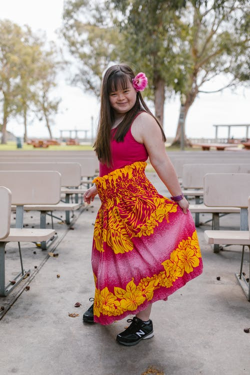 A Girl Holding Her Skirt and Posing