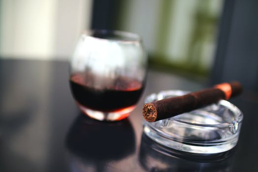Brown Tobacco Beside Drinking Glass