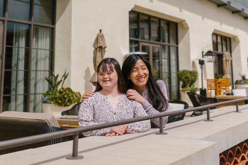Mother and Daughter Standing by the Balcony