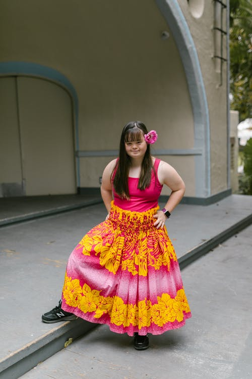 A Girl in Floral Skirt Posing on a Stage