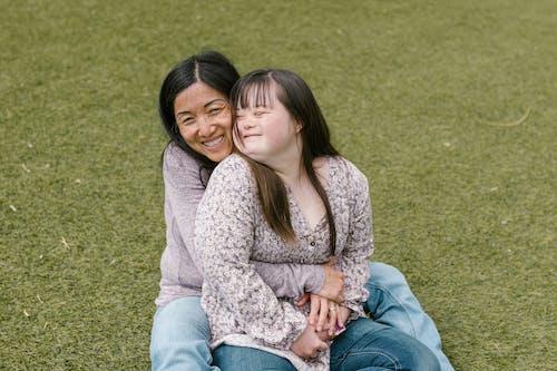 Kostnadsfri bild av dotter, downs syndrom, familj