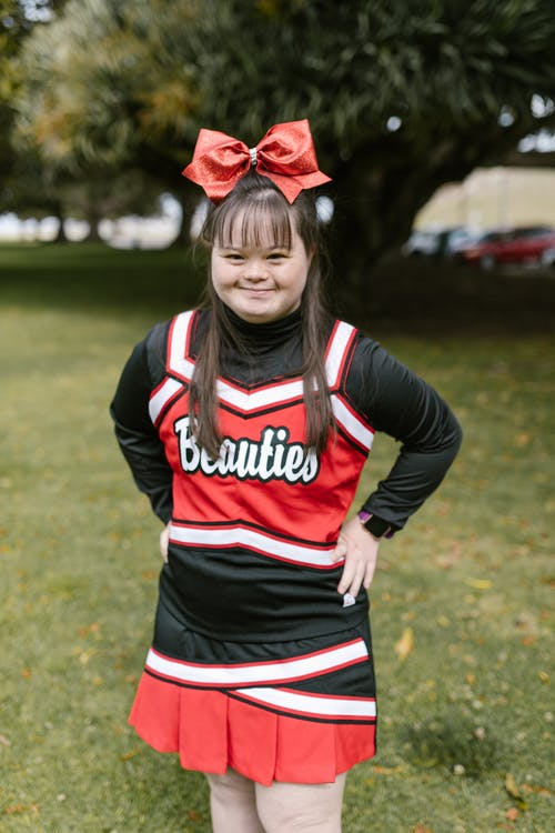 A Cheerleader with a Ribbon on the Top of Her Head