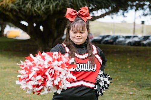 A Cheerleader Holding Pompoms