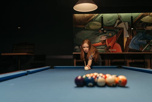 A Woman Playing Billiards