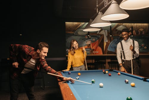 Friends Playing Billiards and Hanging Out
