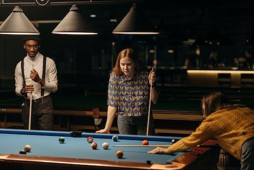 Friends Playing Billiards