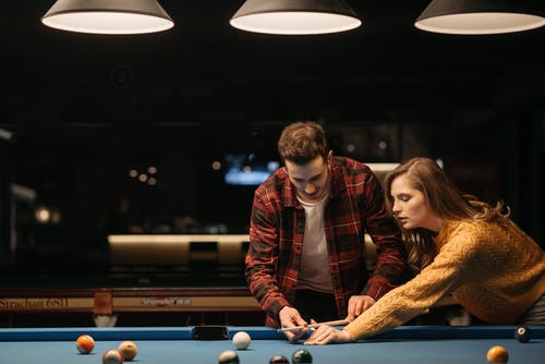 A Woman Learning How to Play Billiards