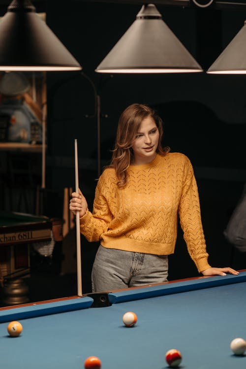 A Woman Holding a Cue Stick