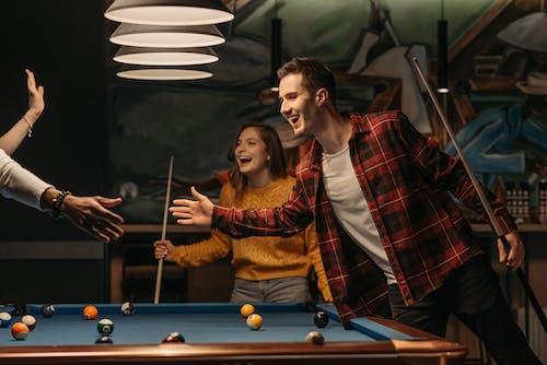 Friends Having Fun Playing Billiards