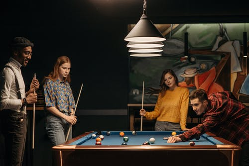 Friends Training and Playing Billiards