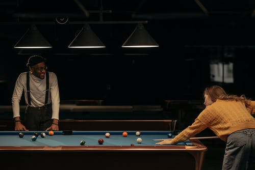 Person Hitting the Cue Ball