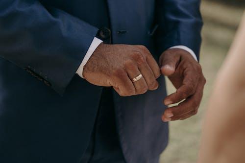 Man in Blue Suit Jacket Wearing Gold Wedding Band