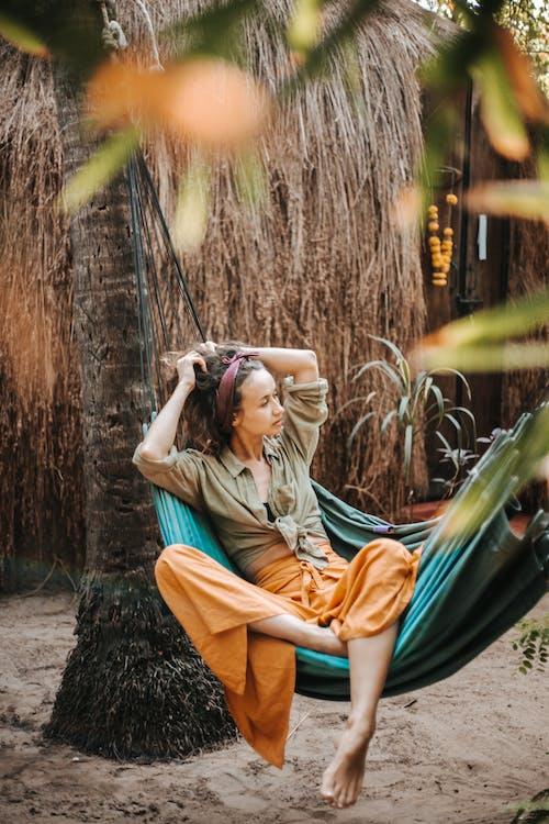 A Beautiful Woman Lying on a Hammock