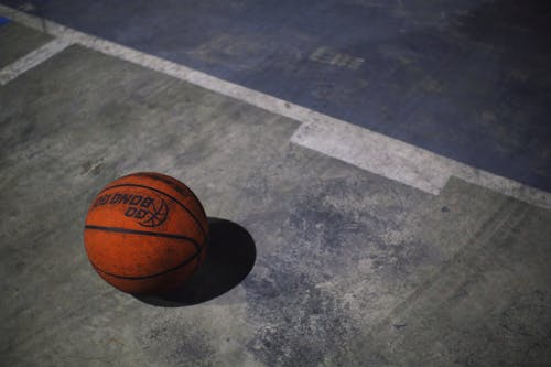 Orange basketball ball on playground