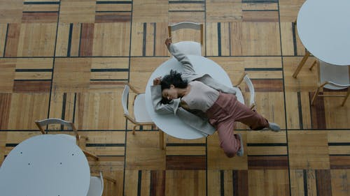 A Woman in a Blazer Lying Down on a Table