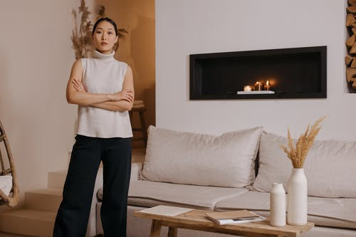 A Cozy Living Room and a Woman with Her Arms Crossed