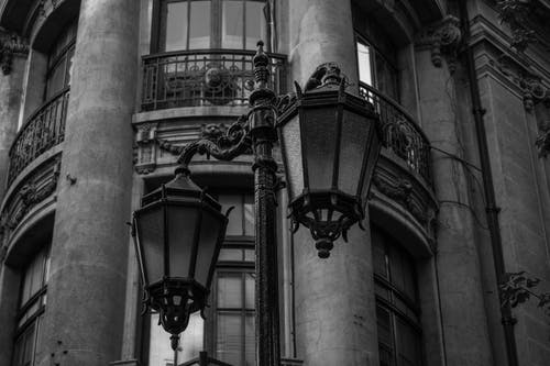 A Building and a Street Lamp in Black and White
