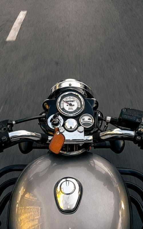 Grey Motorcycle With Black and Brown Motorcycle
