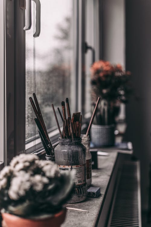 Paintbrushes and Holders on the Window Sill