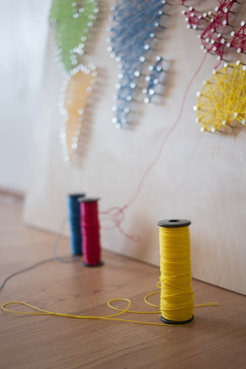 Colorful Spools of Threads and a String Art