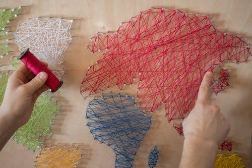 A Person Making a String Art