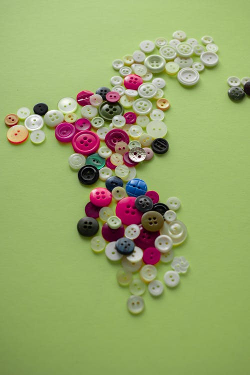 Assorted Color Buttons on Green Background