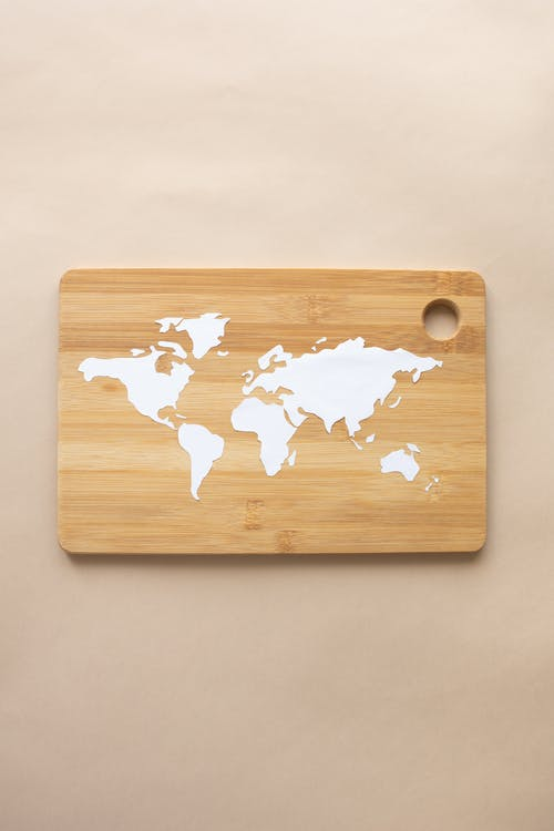 A World Map Paper Cutting on a Chopping Board