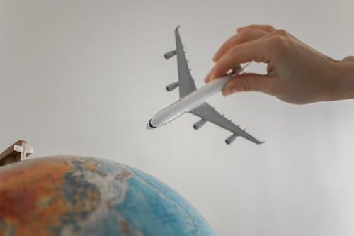 Close-Up Shot of a Person Holding an Airplane Toy