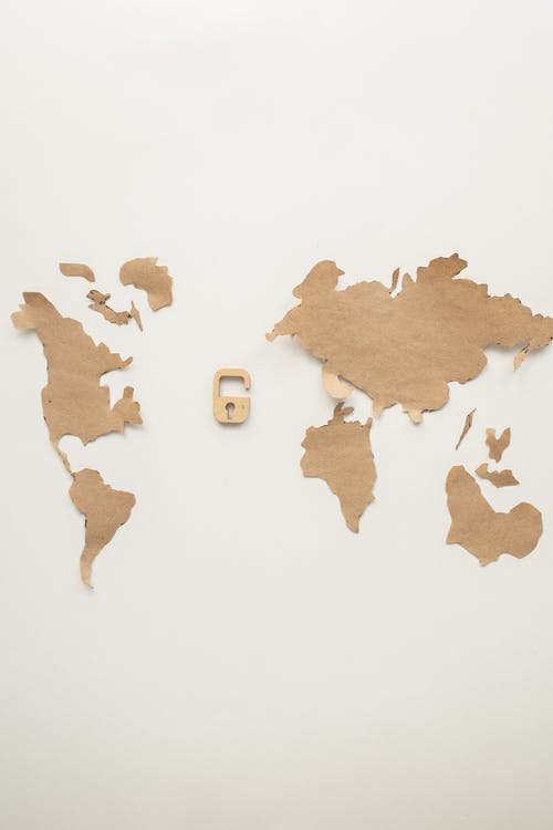 A World Map and a Padlock Paper Cutting