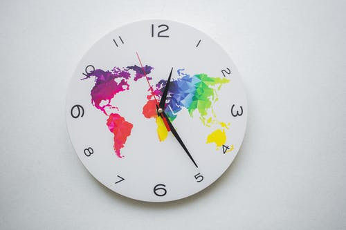 A Wall Clock with a Colorful World Map Design