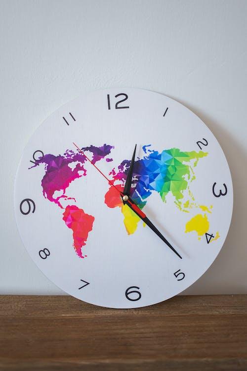 White and Pink Analog Wall Clock at 10 00