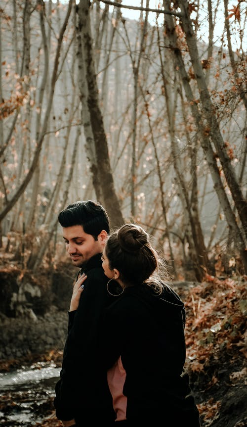 Stylish couple embracing in autumn park