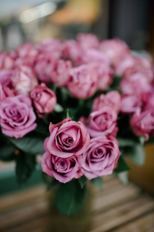Bouquet of roses on table