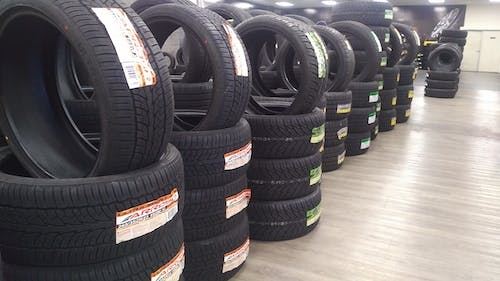 Free stock photo of automotive, stack of tires, tire shop