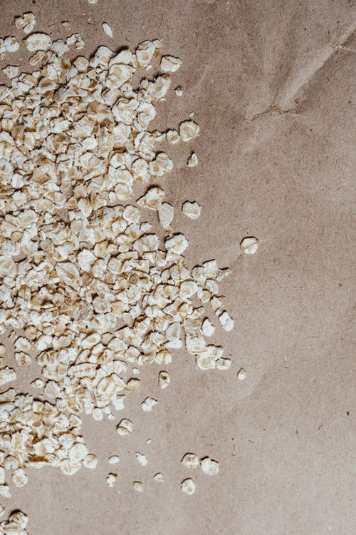 White and Brown Stones on Brown Sand